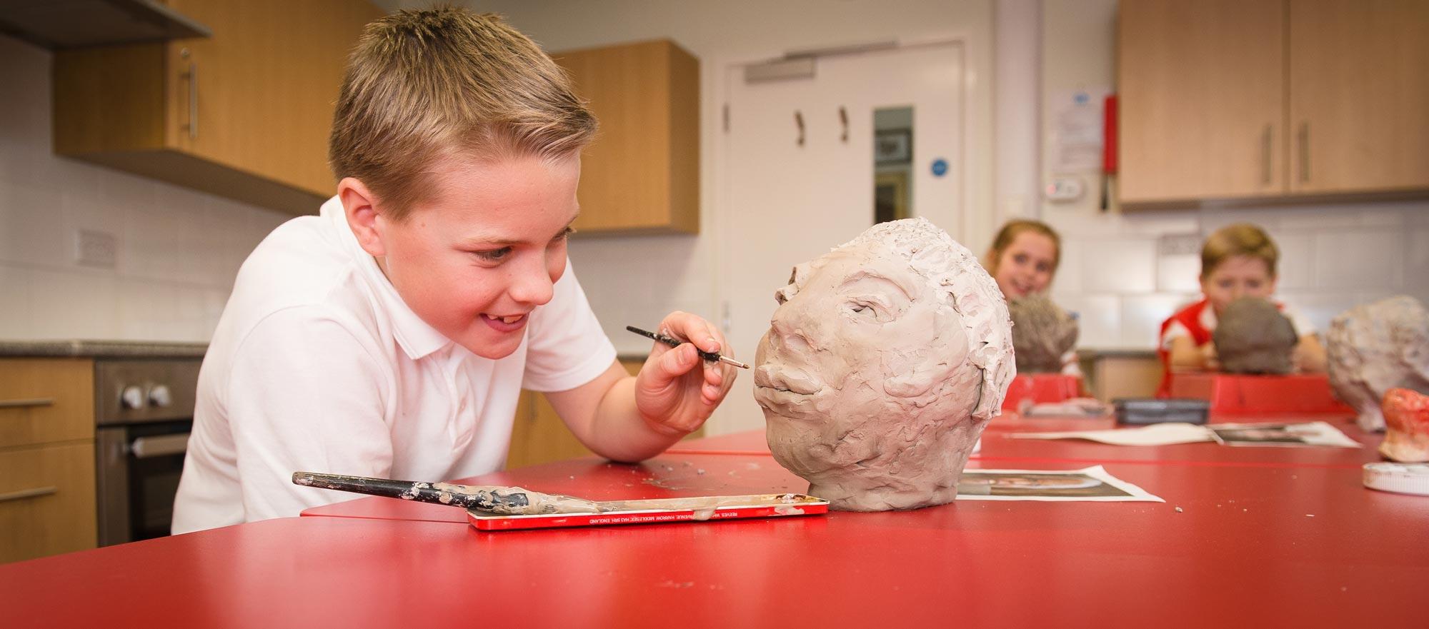 boy_making_clay_sculpture