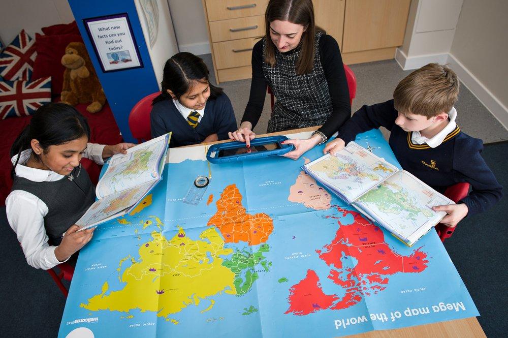 Children studying map